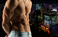 Close up of male bodybuilder bare torso sport bodybuilding strength and people concept over night city background Royalty Free Stock Photography