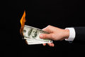 Close up of male hand holding burning dollar money Royalty Free Stock Photo