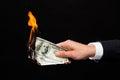 Close up of male hand holding burning dollar money Royalty Free Stock Photo