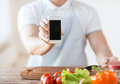 Close up of male hands holding smartphone cooking technology advertising and home concept with blank black screen Royalty Free Stock Photography