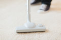 Close up of male hoovering carpet cleaning and home concept Royalty Free Stock Image