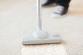 Close up of male hoovering carpet Royalty Free Stock Photo