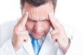 Close-up of male medic or doctor feeling a headache Royalty Free Stock Photo