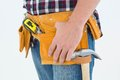 Close up of male repairman wearing tool belt on white background Royalty Free Stock Photo