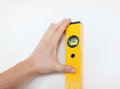 Close up of male with spirit level mesuring wall Royalty Free Stock Photo