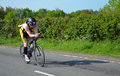 Close up of Male triathlete competitor on road cycling stage. Royalty Free Stock Photo