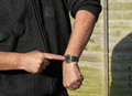 Close up man checking his watch. You are late. Royalty Free Stock Photo