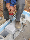Close-up of man drilling concrete block Royalty Free Stock Images