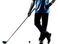 Close up man golfer golfing silhouette one in studio isolated on white background Royalty Free Stock Photo