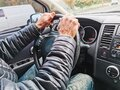 Close up man hands holding steering wheel. Driving car, soft selective focus Royalty Free Stock Photo