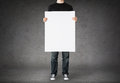 Close up of man holding big blank white board Royalty Free Stock Photo