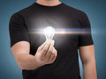 Close up of man holding light bulb electricity and energy concept Stock Images
