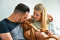 Close-up of man kissing dog with girlfriend Royalty Free Stock Photo