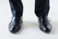 Close up of man legs in elegant shoes with laces Royalty Free Stock Photo