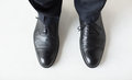 Close up of man legs in elegant shoes with laces people business fashion and footwear concept or lace boots Stock Images