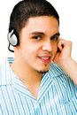 Close-Up Of Man Listening To Headphones Royalty Free Stock Photography
