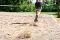 Close up of a man running through soil low angle view jogging on ground Royalty Free Stock Photography