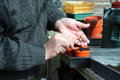 A close up of a man sowing seeds in pots of compost Stock Images