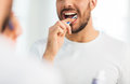 Close up of man with toothbrush cleaning teeth Royalty Free Stock Photo
