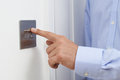 Close Up Of Man Turning Off Light Switch Royalty Free Stock Photo