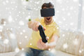 Close up of man in virtual reality headset playing Royalty Free Stock Photo