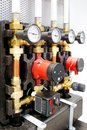Close up of manometer, pipe, flow meter, water pumps and valves of heating system in a boiler room Royalty Free Stock Photo