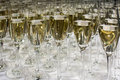 Close up of many champagne glasses on table Stock Images