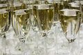 Close up of many champagne glasses on table Stock Photo