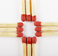 Close up of matches, arranged three on cross Royalty Free Stock Photography