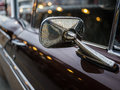 Close-up mirror sideview of classic car, have more dirty dust an Royalty Free Stock Photo