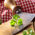 Close up of a modern herb cutter wiegemes with wooden handles and a sprig of parsley on the blade Stock Photos