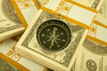 Close up money and compass concept Stock Images