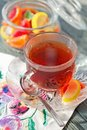 stock image of  Close up of a morning black tea and colorful marmalades in glass jar on wooden table