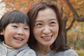 Close up of mother and daughter smiling in the park autumn portrait Royalty Free Stock Photo