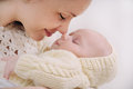 Close up mother's face touching nose by nose of her baby Royalty Free Stock Photo