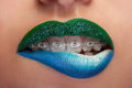 Close up mouth blue and green lips with glitter brackets