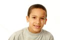 Close up of multi ethnic boy portrait smiling mixed race isolated on white Royalty Free Stock Photography