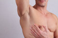 Close up of muscular male torso chest and armpit hair removal male waxing Stock Image