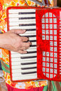 Close-up the musician fingers playing the red accordion, the str Royalty Free Stock Photo