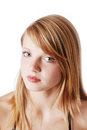 Close up of natural blonde teenage girl cut out is looking at the camera with great attention is photographed and isolated on Royalty Free Stock Photography