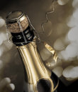 Close-up from nearly opened sparkling wine bottle with sparks on the background. Royalty Free Stock Photo