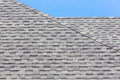 Close up of new rubber roof tiles with blue skybackground Royalty Free Stock Photography