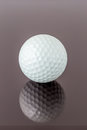 Close up the new white golf ball with the reflection, sport conc Royalty Free Stock Photo