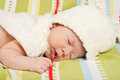 Close up of newborn baby boy sleeping with fur bunny hat Stock Photos