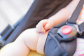 Close-up of newborn baby hand while sleeping in stroller outdoors Royalty Free Stock Photo
