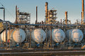 Close up of oil refinery at sunset Royalty Free Stock Photo