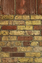 Close up old brick wall there two main brick colors red yellow picture was taken indoors Stock Photo