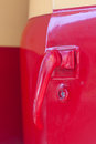 Close up old and dirty red car door handle yellow color paint vintage automobile Stock Photo