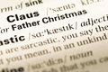 Close up of old English dictionary page with word father christmas Royalty Free Stock Photo