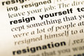 Close up of old english dictionary page with word resign yourself Stock Photo